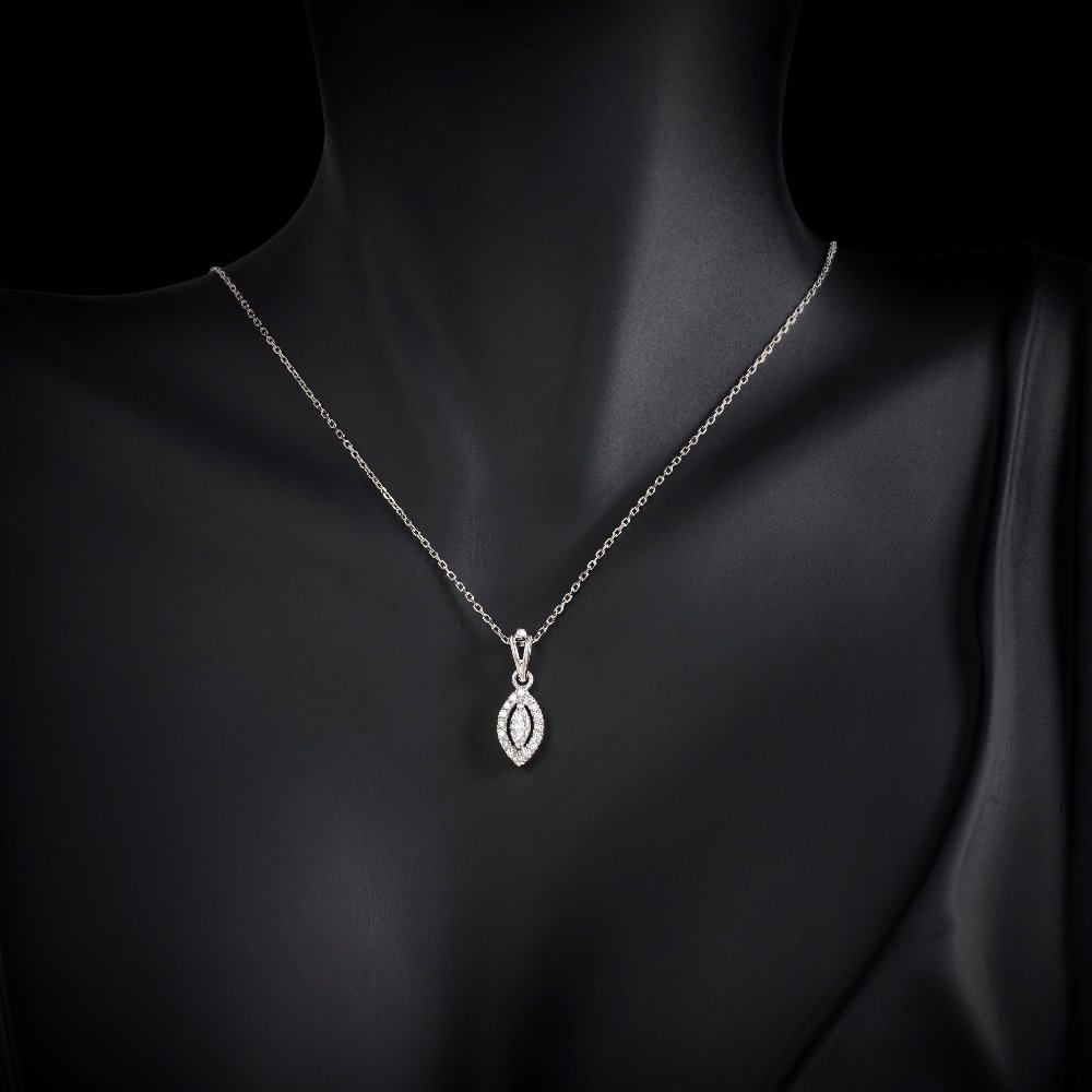 Marquise Cut Diamond Pendant With A Halo Surround